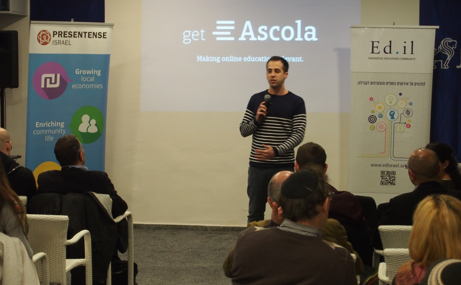 Yonathan Bendahan from Ascola, a platform for easy online learning, giving his four-minute pitch. Photo by Nitzan Adler