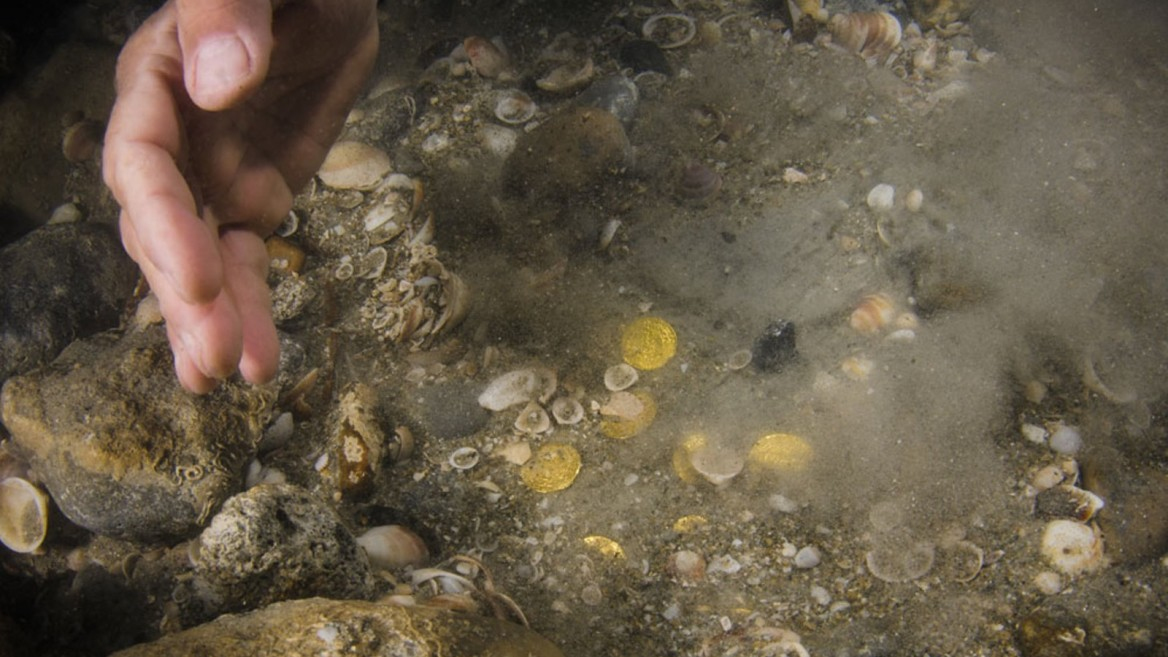 Divers recently chanced upon a huge cache of gold coins off the coast of Caesarea. Courtesy of Israel Antiquities Authority
