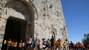 Runners take part in Jerusalem Marathon. Photo via Flash 90