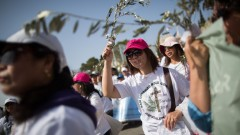 Christian pilgrims take part in the traditional Palm Sunday procession on the Mount of Olives, March 29, 2015.Photo by Yonatan Sindel/FLASH90
