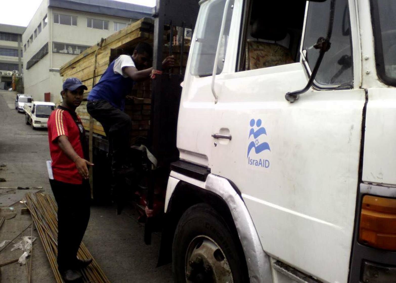 IsraAID is distributing building supplies in Fiji. Photo via Facebook