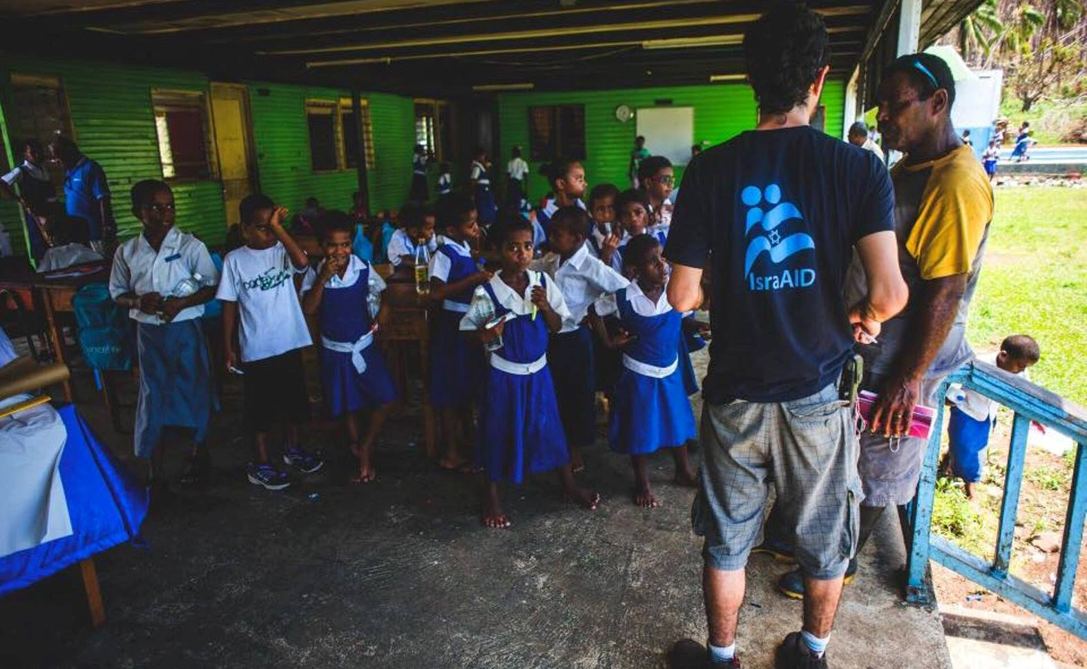 An IsraAID volunteer working with schoolchildren in Fiji. Photo via Facebook