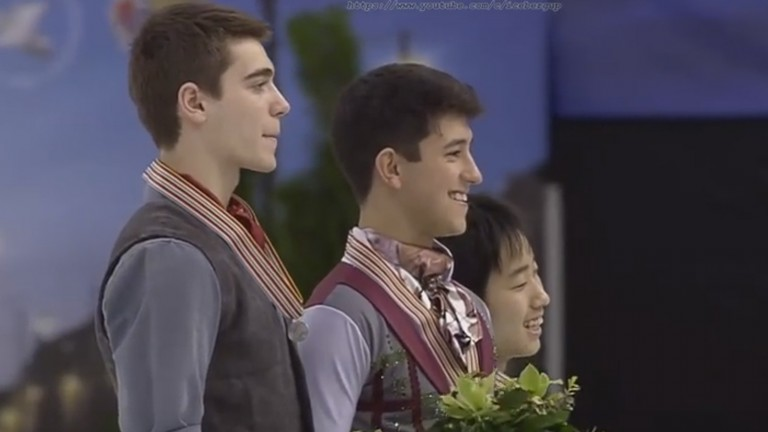 Israeli figure skater Daniel Samohin (center) flanked by Canadian Nicolas Nadeau and Tomoki Hiwatashi, of the US, at the 2016 World Junior Figure Skating Championships in Debrecen, Hungary.  Photo via YouTube