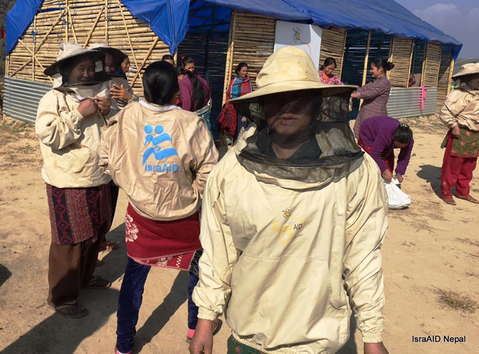 IsraAID's HoneyAID project equips and trains Nepalese women to be beekeepers. Photo courtesy of IsraAID Nepal