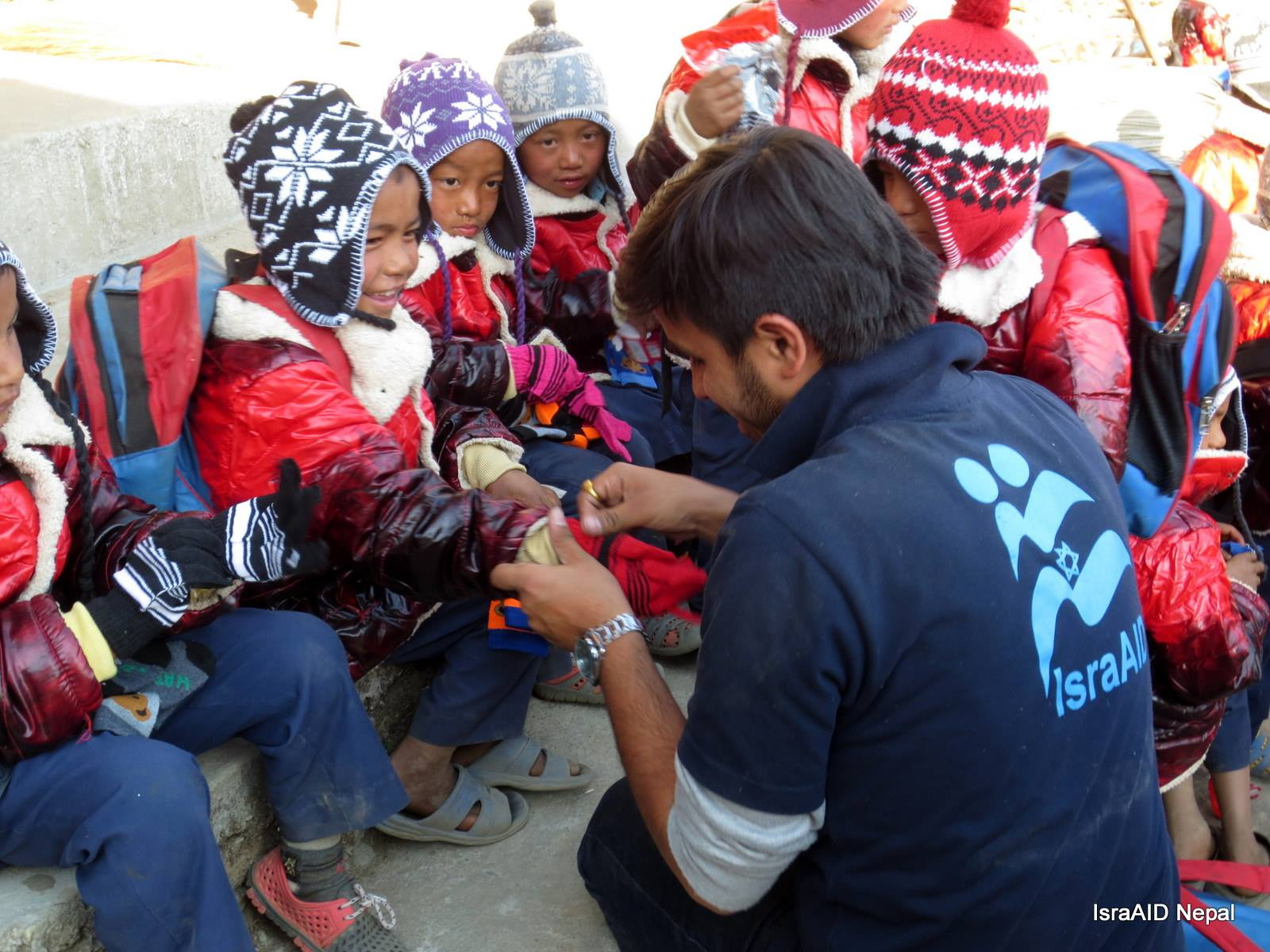 IsraAID and a partner NGO distributed warm clothing to 1,000 children in earthquake-affected communities of Nepal. Photo courtesy of IsraAID Nepal