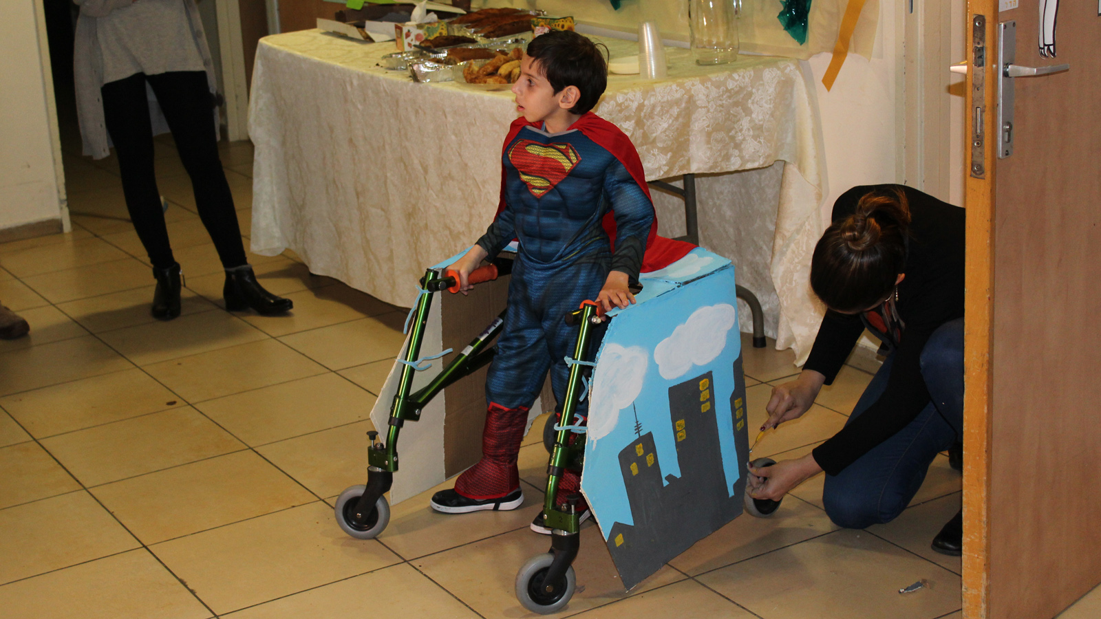 Design students helped six-year-old Brian become Superman for the day. Photo courtesy of Beit Issie Shapiro