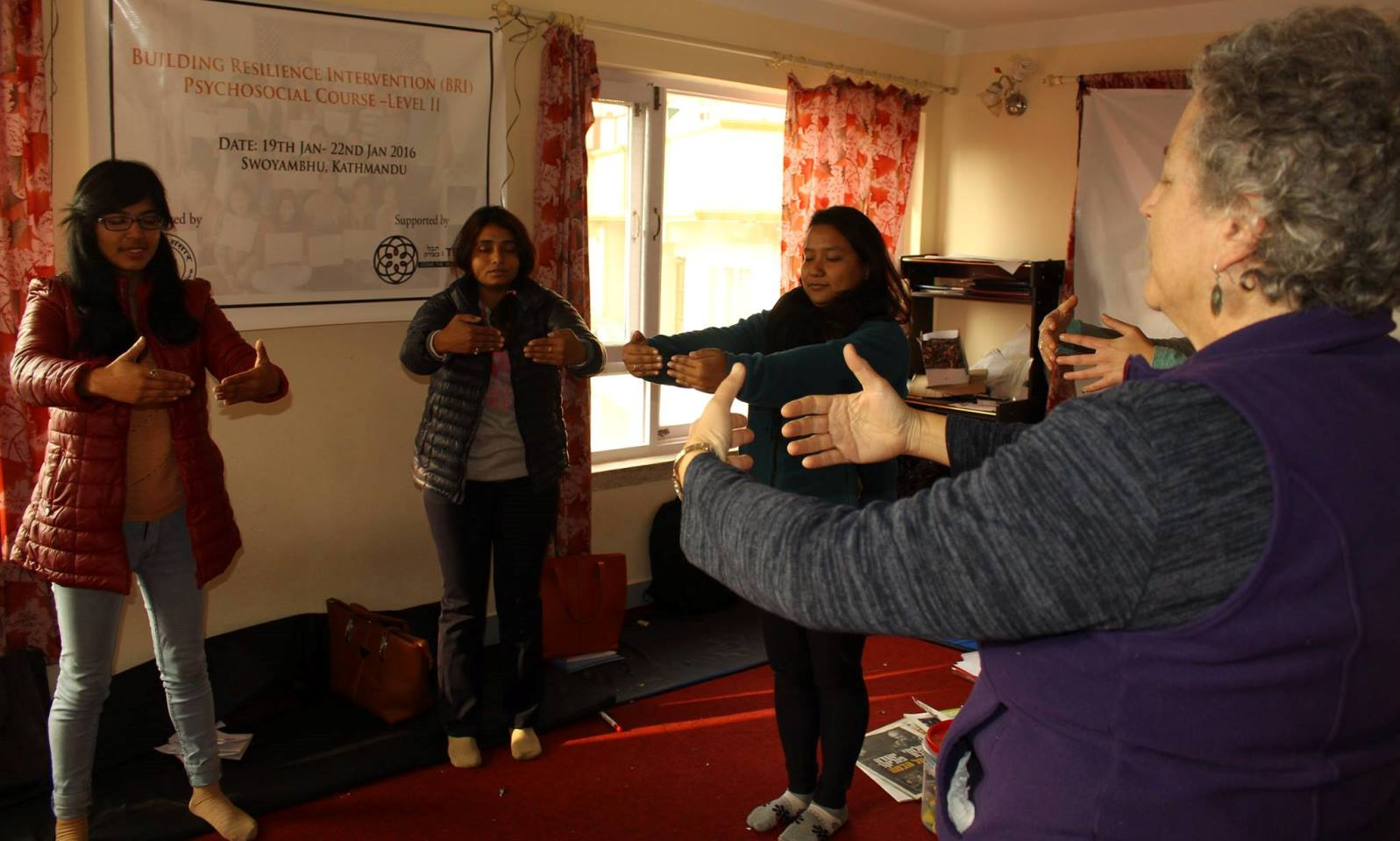 Naomi Baum, retired founder-director of the Resilience Unit at theIsrael Center for the Treatment of Psychotrauma of Jerusalem's Herzog Hospital, teaching resilience techniques to Nepalese women on behalf of Tevel b'Tzedek. Photo via Facebook