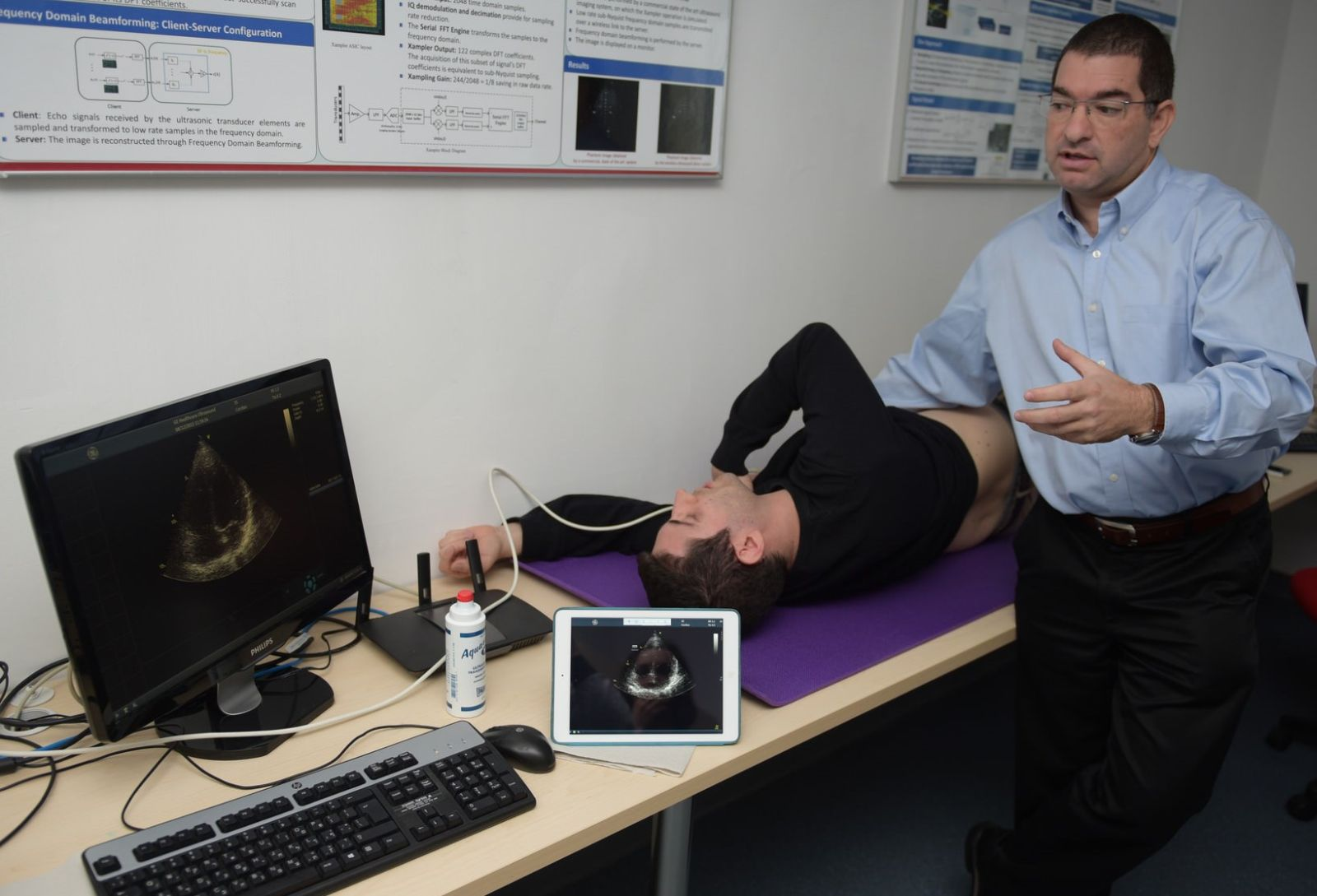 Dr. Shai Tejman-Yarden demonstrating the mobile ultrasound imaging system on Technion student Regev Cohen. Photo courtesy of Technion Spokesperson's Office