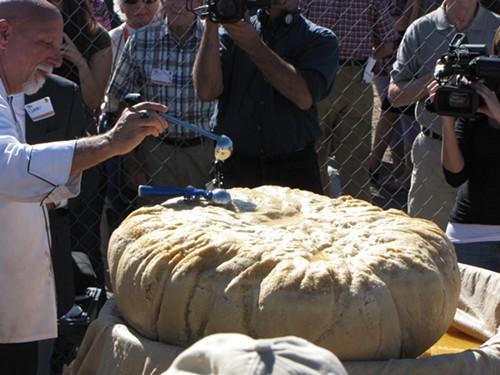 Chef Jon Wirtis puts the finishing touches on the world's largest matzah ball. Photo via World Record Academy