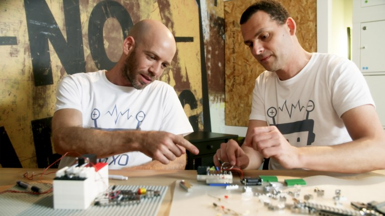 Founders Amir Saraf, left, and Boaz Almog playing with BRIXO. Photo courtesy