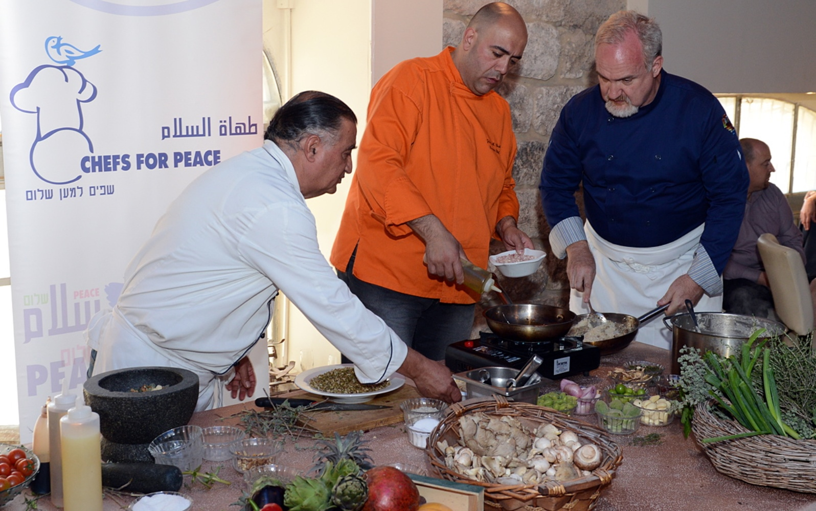 Johnny Goric, center, cooking at a Chefs for Peace event at Eucalyptus restaurant in Jerusalem. Photo courtesy of US Embassy