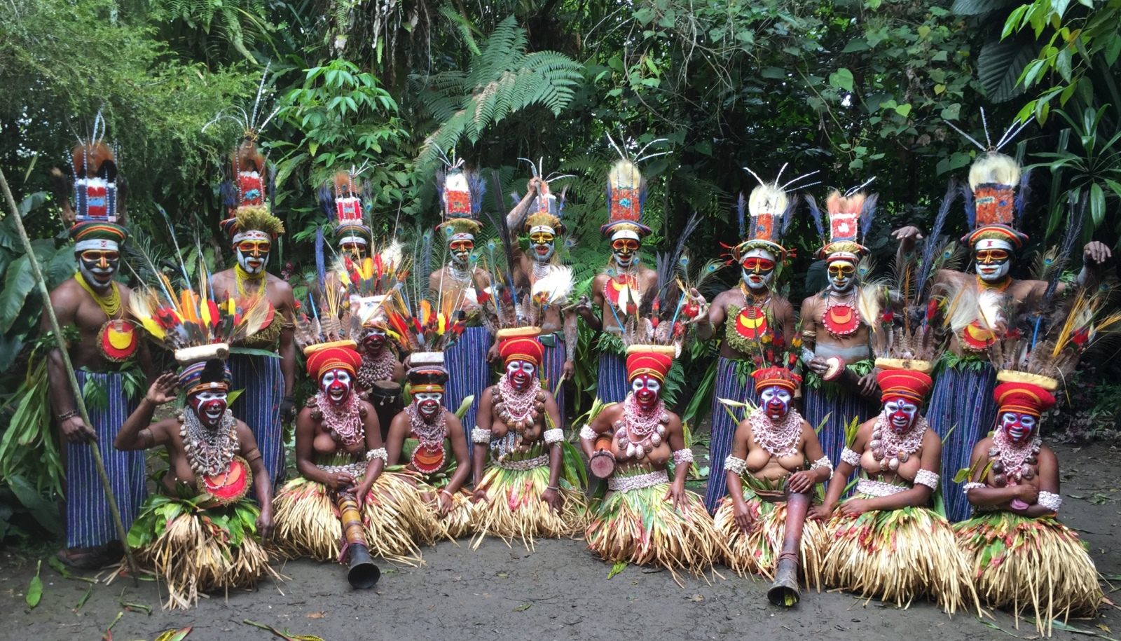 "MyHeritage interviewers joined in a festive ""sing-sing"" in Papua, New Guinea. Photo by Golan Levi"