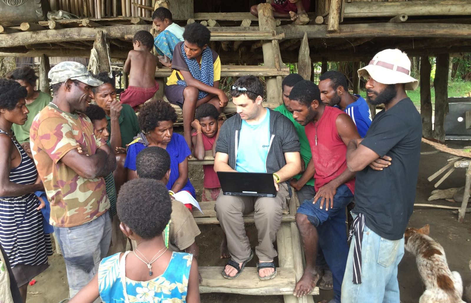 Ohad Nitzan of MyHeritage gathering genealogical information from local families in Papua, New Guinea. Photo by Golan Levi