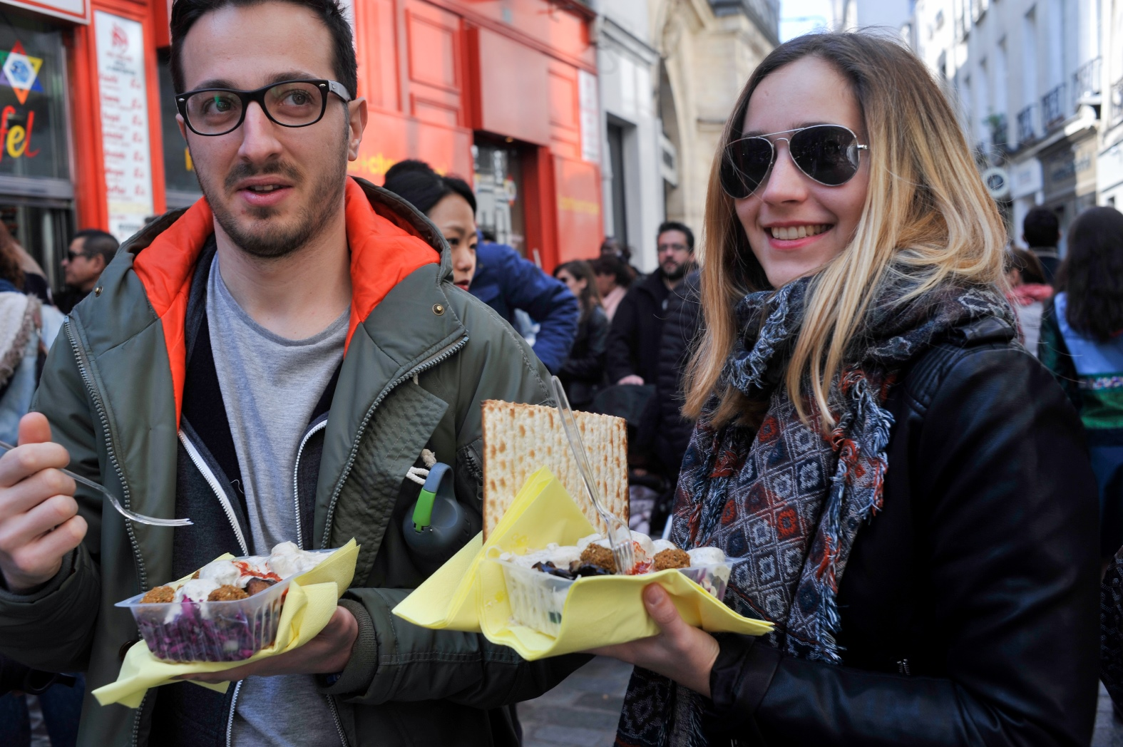 Tourists eating falafel with matzah during Passover last year in Paris. Photo by Serge Attal/FLASH90