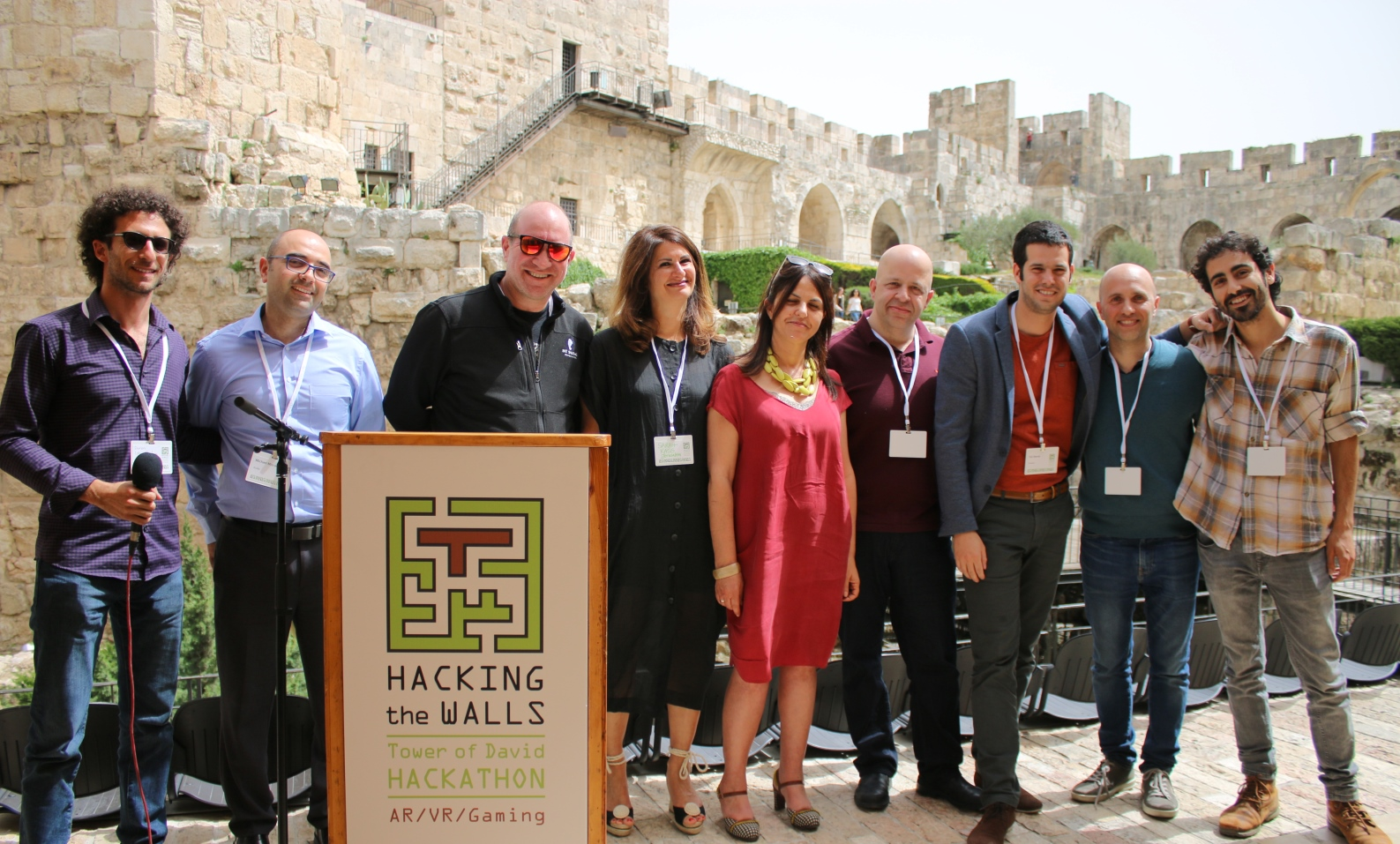 Cap: From left, Doron Ish Shalom of the Israel Innovation Institute, AtoBe Accelerator Director Michael Mizrahi, Elie Wurtman of PICO Partners, Sarah Kass of iJerusalem, Tower of David Museum director Eilat Lieber, Itzik Ozer of the Jerusalem Development Authority, and the second-place Proverb team. Photo courtesy of the Tower of David Museum