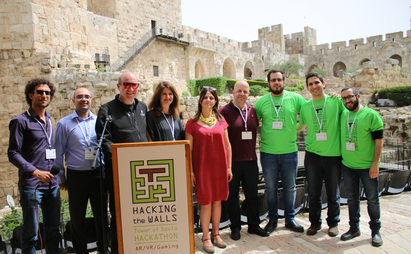 From left, Doron Ish Shalom, Michael Mizrahi, Elie Wurtman, Sarah Kass, Eilat Lieber, Itzik Ozer and third-place Hacking the Walls winner Clusteron. Photo courtesy of the Tower of David Museum