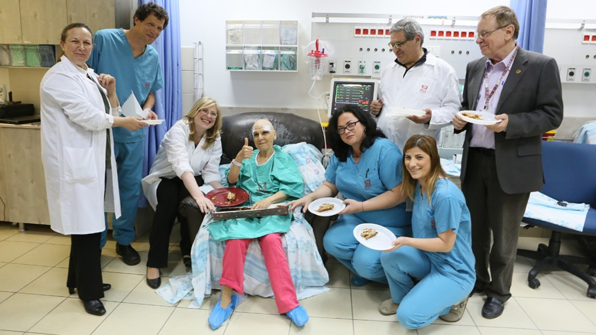 Celebrating with the patient immediately afterward her treatment with Exablate Neuro are Rambam Medical Center physicians Menashe Zaaroor, Alon Sinai, Ilana Schlesinger and Dorith Goldsher along with other support staff. Photo by Pioter Fliter/Rambam Health Care Campus