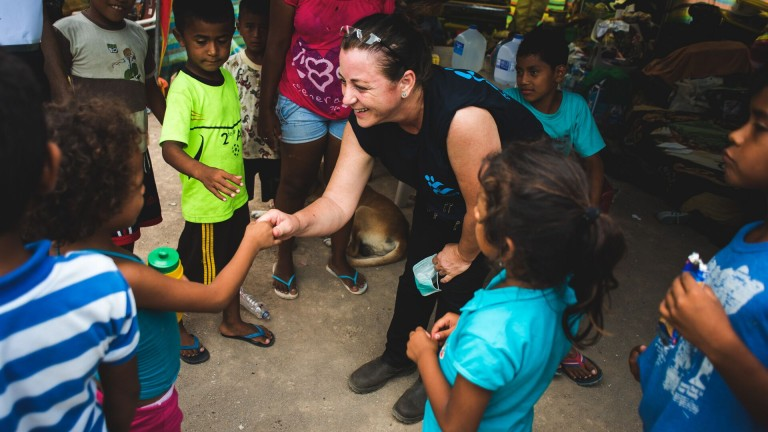 An IsraAID volunteer pictured with Ecuadorean children in Canoa, on April 23, 2016. Photo by IsraAID