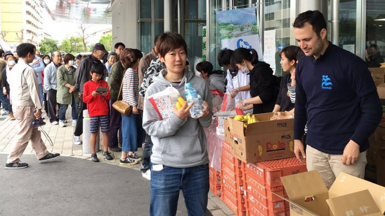 Israeli aid volunteers distribute supplies to Japanese earthquake survivors. Photo via IsraAID