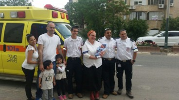 From left, the Sabag family with the crew that delivered their newest addition: Adi Rachamim, Orit Ochana, Nati Liani and Yossi Akris. Photo by MDA Spokesman