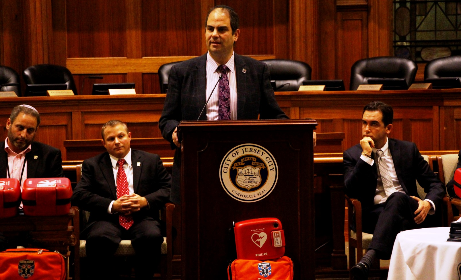 Eli Beer speaking at the first EMT graduation ceremony for United Rescue in Jersey City. Photo by Yadin Goldman
