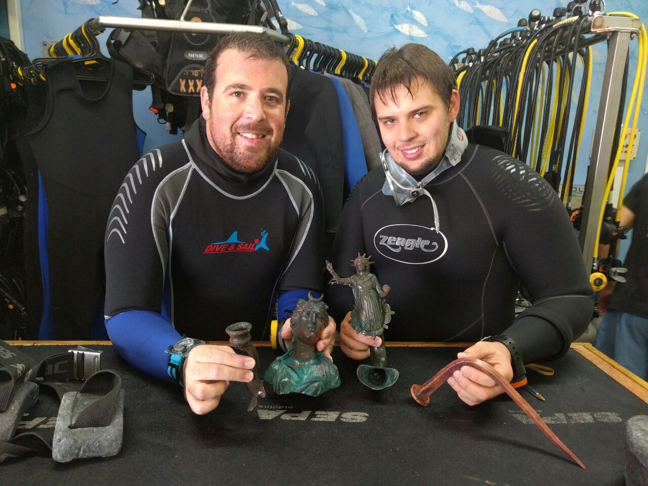 Exemplary citizenship: Divers Ran Feinstein (right) and Ofer Ra'anan after the discovery. Photo courtesy of the Old Caesarea Diving Center