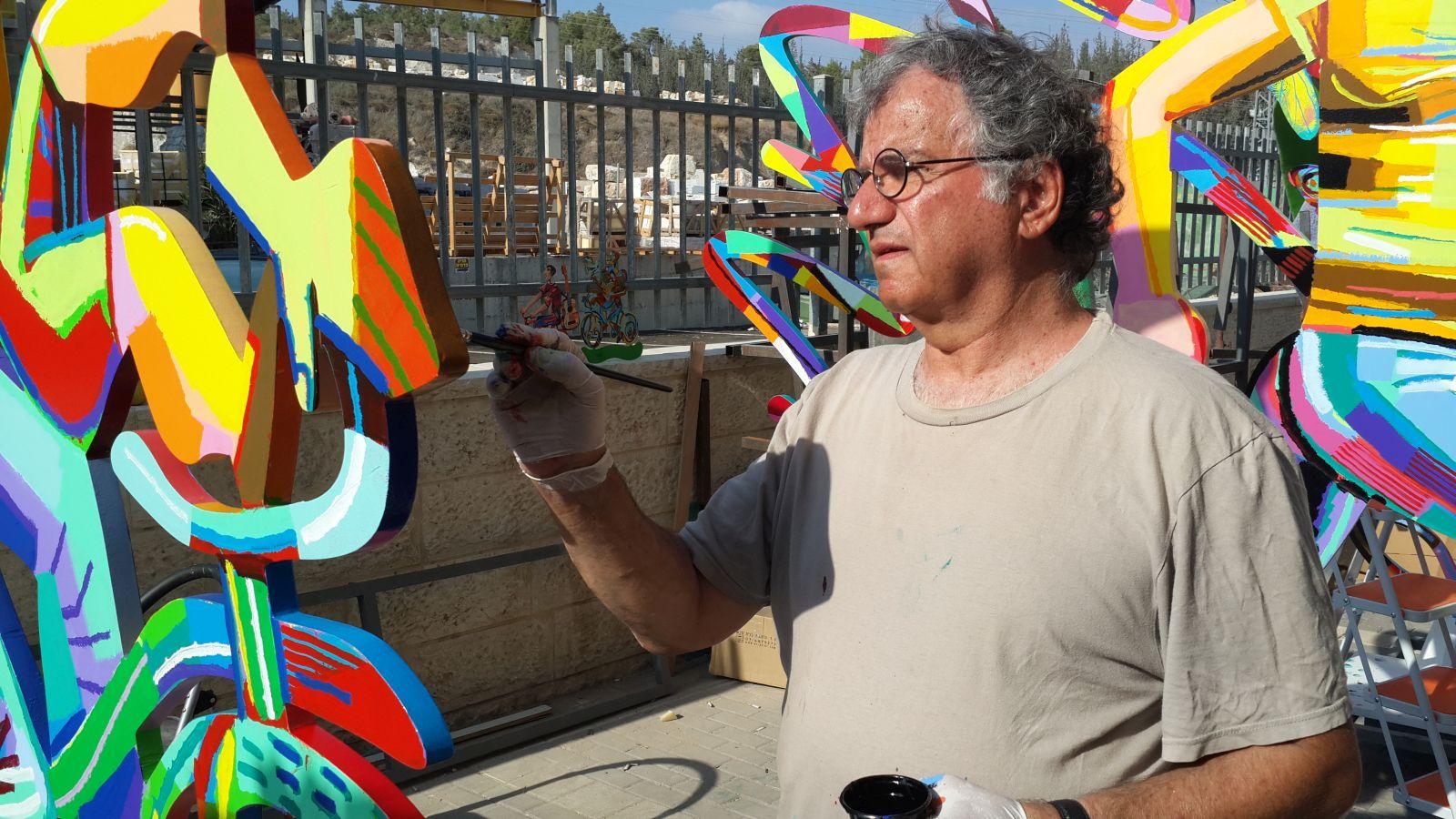 The artist at work. Photo courtesy of David Gerstein