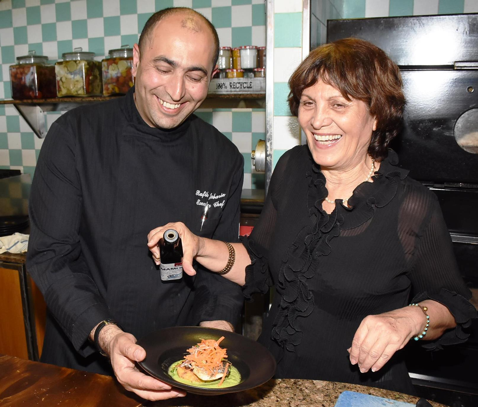 Tel Aviv Hilton Executive Chef Rafik Jabarin with Umamix developer Aliza Raviski. Photo courtesy of Hilton Hotels Worldwide