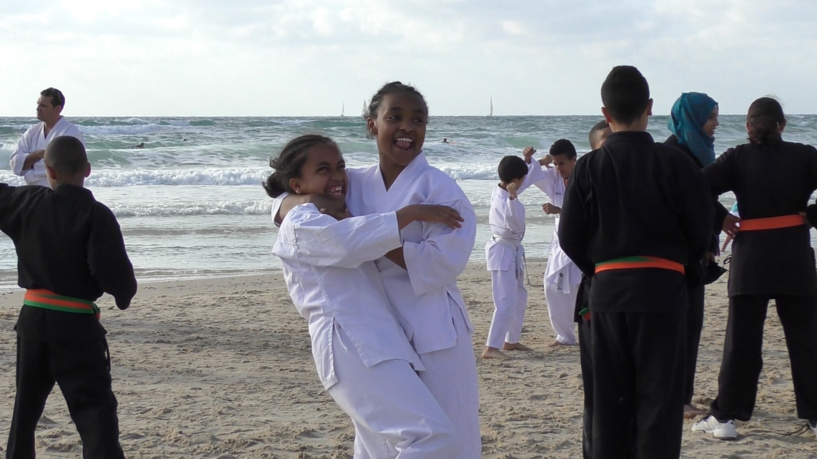 Learning martial arts together is fun. Photo courtesy of Budo for Peace