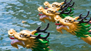 Dragon Boats sport a dragon's head and tail. Photo via Shutterstock