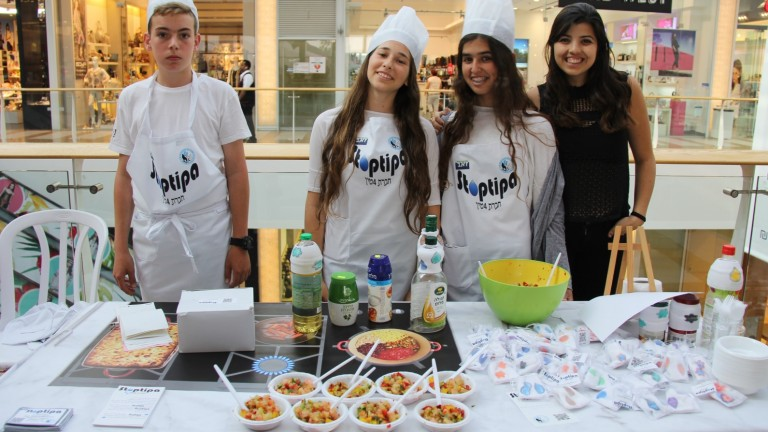 The StopDrop team from Herzliya invented an absorbent drip-stopper for bottles. Photo courtesy of Young Entrepreneurs