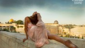 A yoga pose against the backdrop of the Old City of Jerusalem. Photo by Robert Sturman