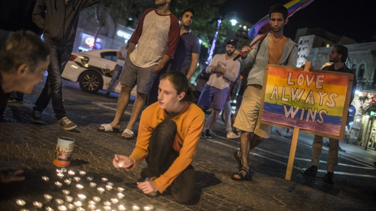 Young Israeli activists light candles for the Orlando victims at Zion Square in Jerusalem. Photo by Hadas Parush/Flash90
