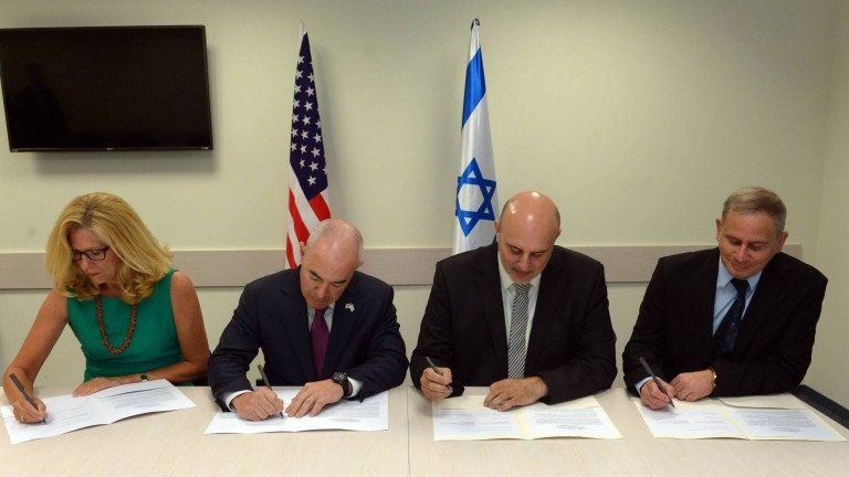 From left, US Under Secretary of Homeland Security Suzanne Spaulding and US Deputy Secretary of Homeland Security Alejandro Mayorkas Alejandro Mayorkas signing a cyber defense cooperation declaration with Israel National Cyber Bureau Head Dr. Eviatar Matania and National Cyber Security Authority Head Buky Carmeli on June 20, 2016. Photo by Haim Tzach (GPO)