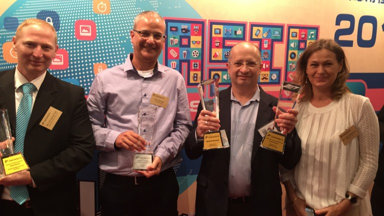 Gil Abramovich of Castle Builders, Eli Polak of Bazz, Dr. Viktor Ariel of Tekoia, and Nicky Blackburn, Editor of ISRAEL21c, at the Asia Smartphone App Contest in Hong Kong.