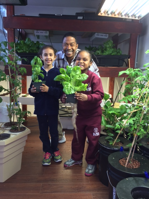 Director of Operations Randy Cameron with Seed Street participants. Photo: courtesy