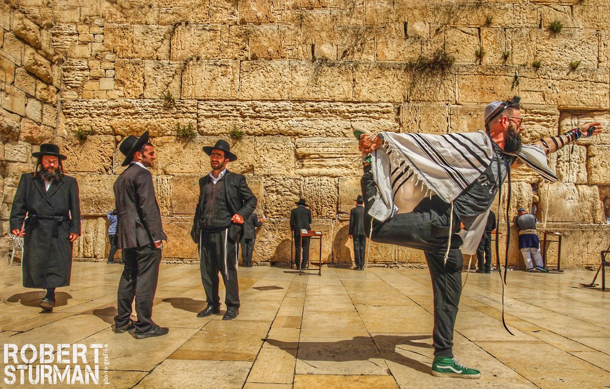 Seth Kaufman doing yoga at the Western Wall in Jerusalem. Photo by Robert Sturman