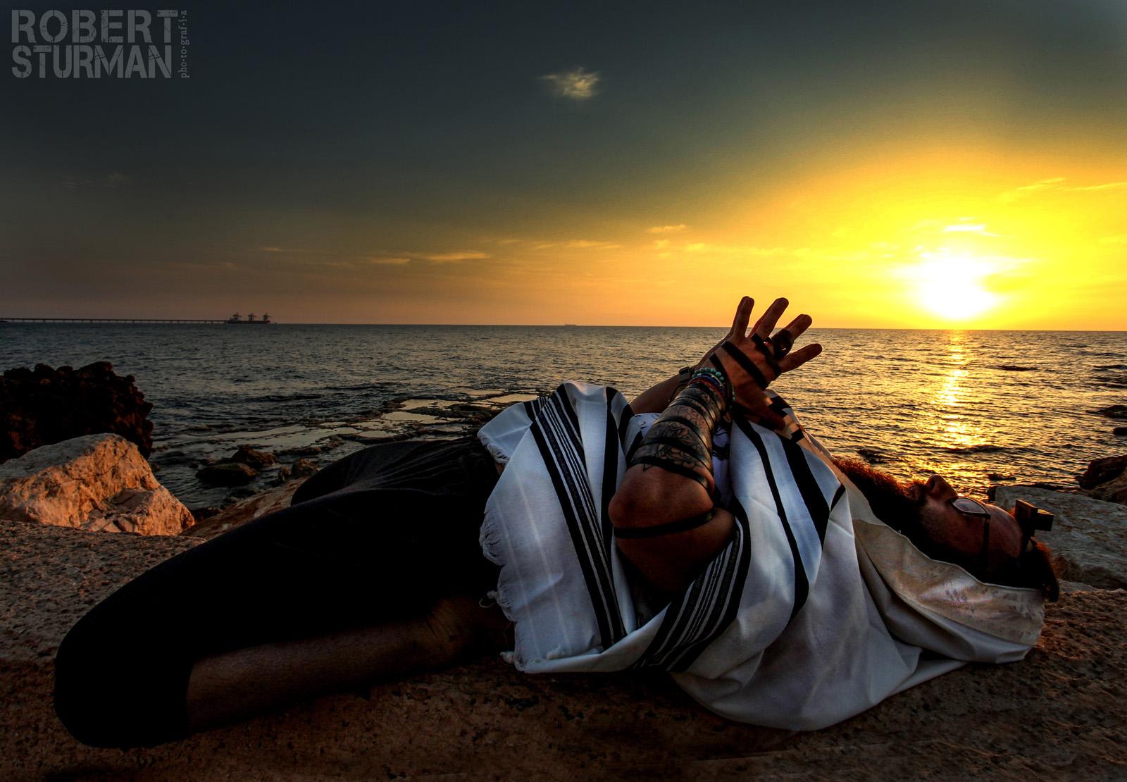 Seth Kaufman doing yoga on the beach in Caesarea as part of his morning prayer ritual. Photo by Robert Sturman