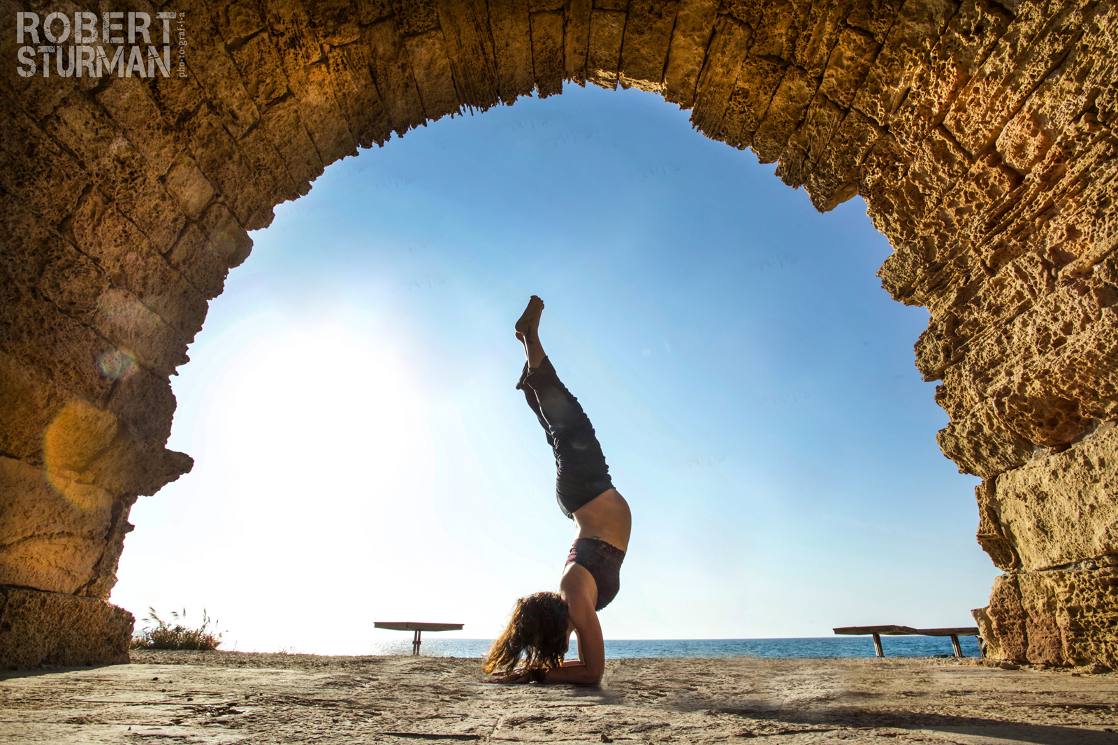 Shiri Segal striking a yoga pose in Caesarea. Photo by Robert Sturman