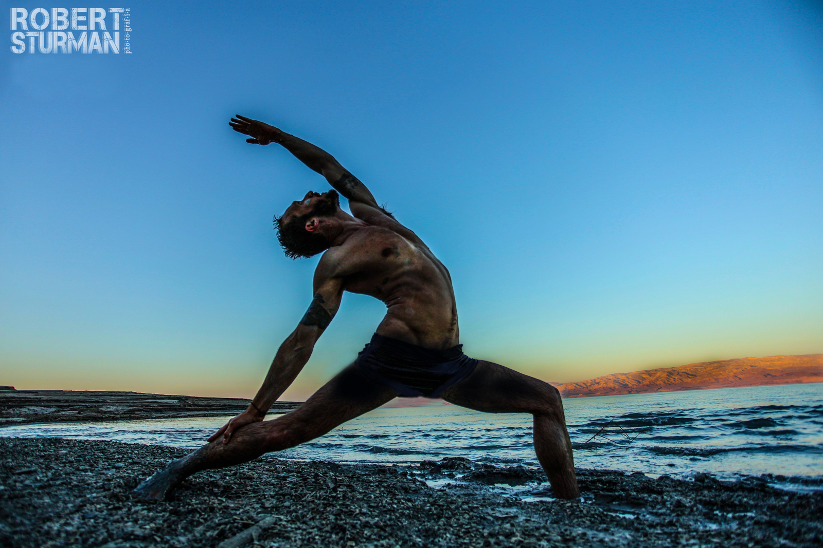 Udi Sahar doing yoga at sundown at the Dead Sea. Photo by Robert Sturman