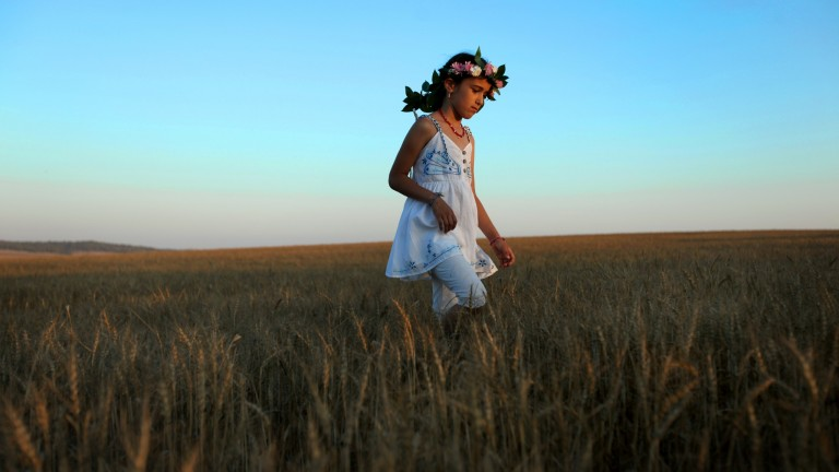 Young Israeli children dress in white for the Jewish holiday of Shavuot. Photo by Moshe Shai/FLASH90