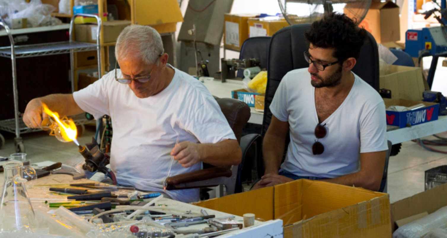 Designer Omer Polak, right, with his glassblower. Photo: courtesy