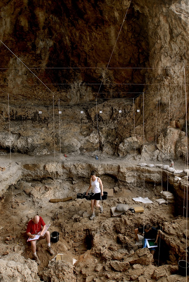 Hebrew University archaeologists uncover 12,000 year old grave inside a cave in northern Israel. Photo by Naftali Hilger