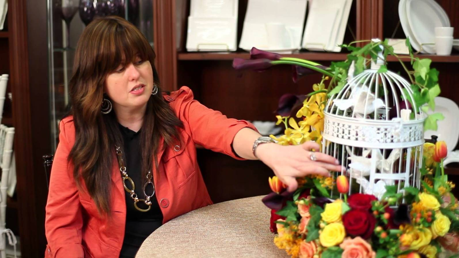 Tammy Carmona Polatsek showing how to use a birdcage as a centerpiece. Photo via YouTube