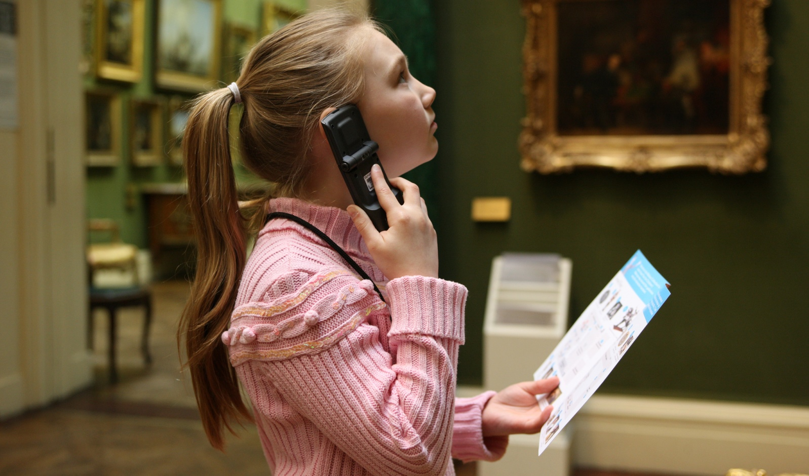 A child using Acoustiguide's Opus multimedia systems at the Wallace Collection, London.