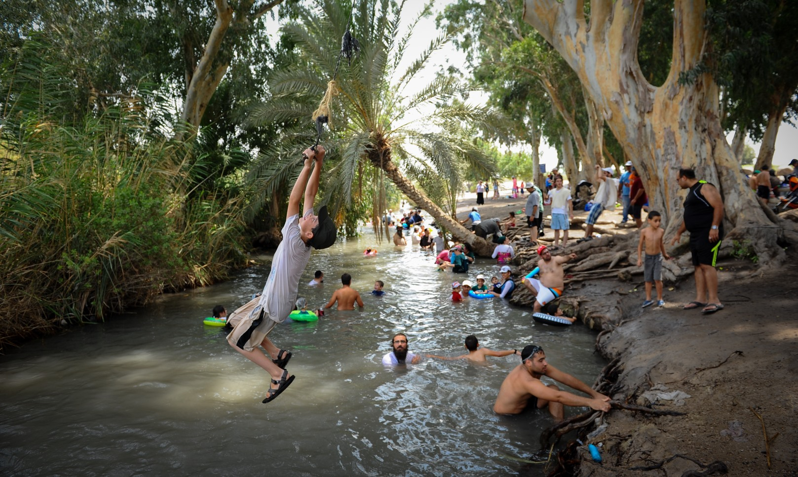 Israelis swim in a natural pool at Nahal Kibbutzim in Beit She'an, northern Israel. Photo by Mendy Hechtman/FLASH90