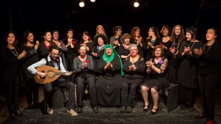 Rana Choir with founder-conductor Mika Danny (center back row, wearing glasses) and artistic director Idan Toledano, front left. Photo by Noa Ben Shalom