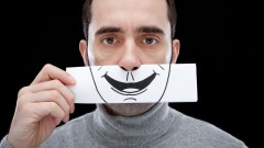 Is that a fake smile? Image via Shutterstock.com