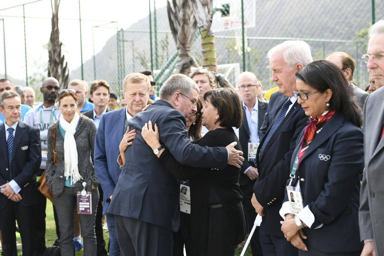 International Olympic Committee President Thomas Bach hugs widows of murdered Israelis during memorial ceremony in Rio. Photo via Israel Olympic Committee/Facebook