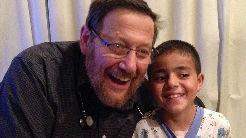 Dr. Rein with Mohamed, who was treated successfully for Marfan syndrome, an inherited disorder that affects the heart. Photo courtesy of A Heart for Peace